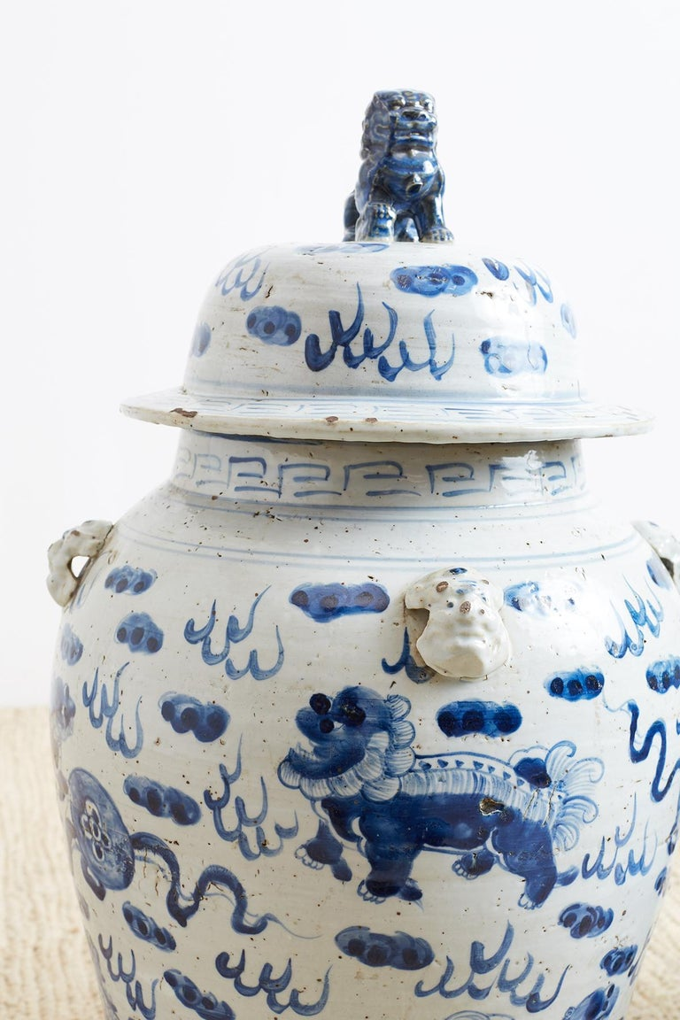 Ceramic Pair of Chinese Blue and White Ginger Jars with Foo Dogs For Sale