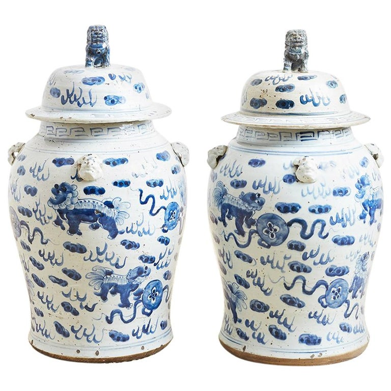 Pair of Chinese Blue and White Ginger Jars with Foo Dogs For Sale