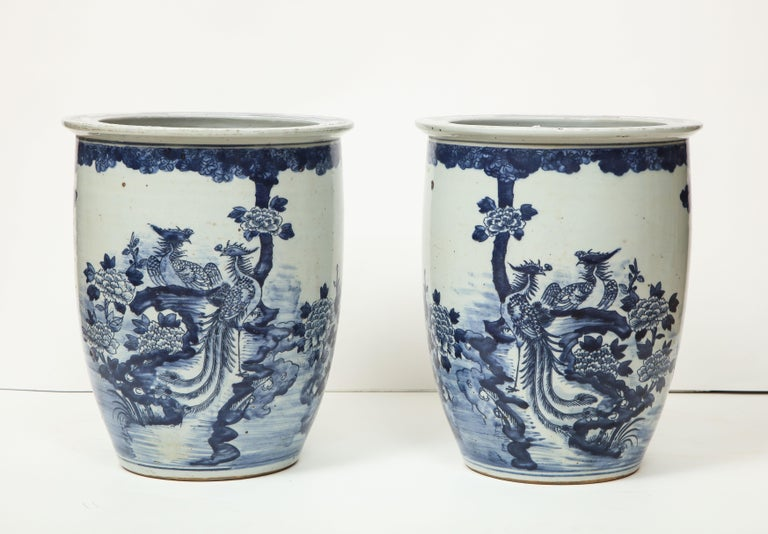 Blue and white goes with everything, and will never go out of fashion. These two Chinese export vases/cachepots look great as stand alone pieces or as vessels for flowers or plants. One side is more heavily decorated, while the other side features a