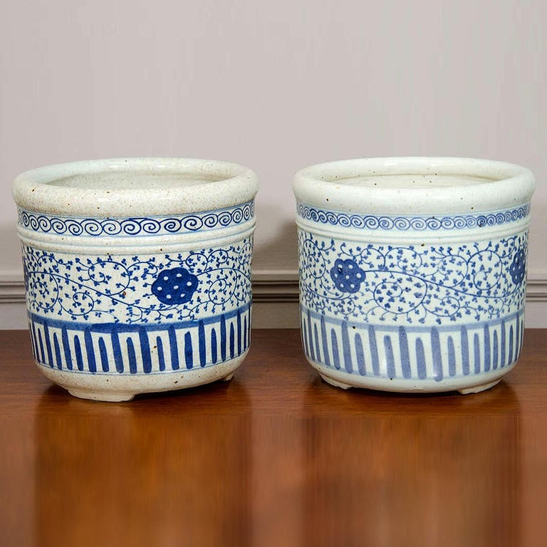 Pair of Chinese Blue and White Porcelain Planters. Ornamented in cobalt with floral and geometric motifs.