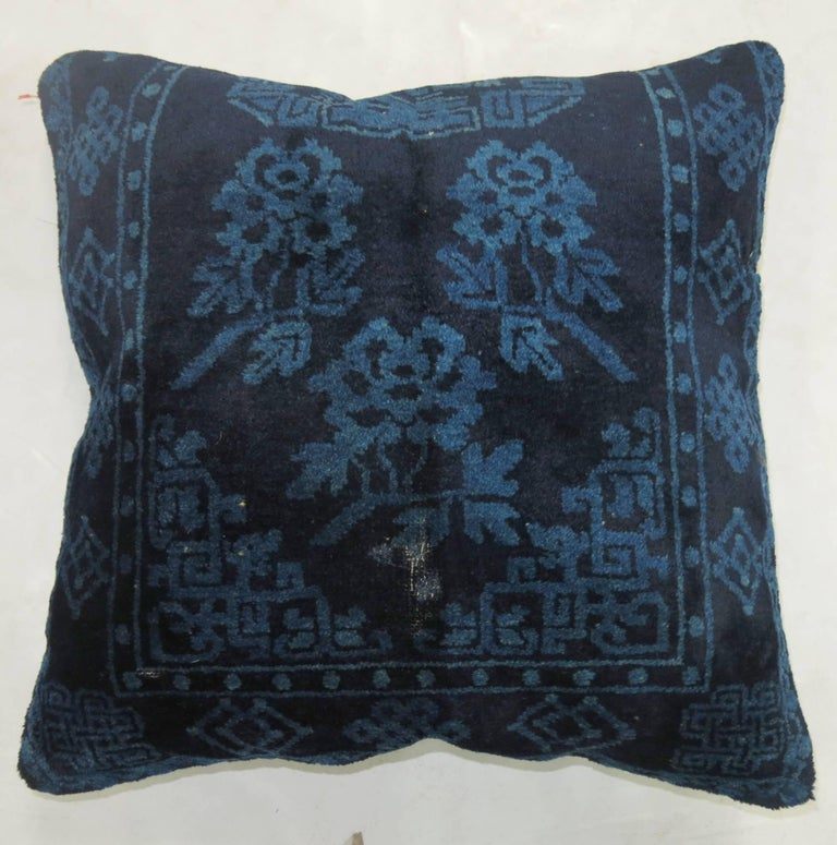 "Set of pillows from a late 19th century dark blue Chinese rug each measuring 18"" x 19"" & 19"" x 19""."