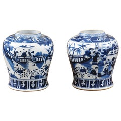 Pair of Chinese Blue and White Figural Ginger Jars