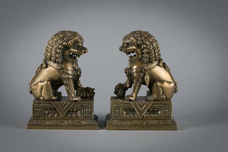 Pair of Chinese bronze foo dogs, circa 1860.
