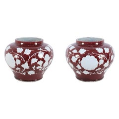 Pair of Chinese Oxblood Ginger Jar Pots with White Floral Design