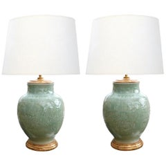 Pair of Chinese Carved Celadon Glazed Ovoid-form Lamps