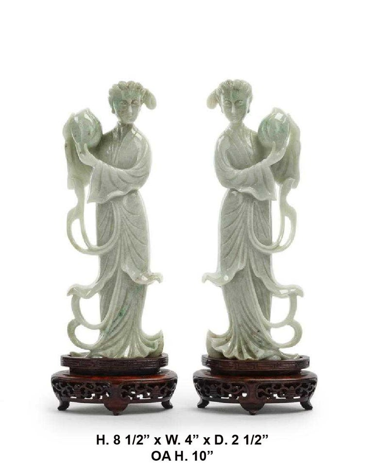 Opposing pair Chinese beautifully carved jade maidens on carved wooden stands.  Jade dimensions: H. 8 1/2