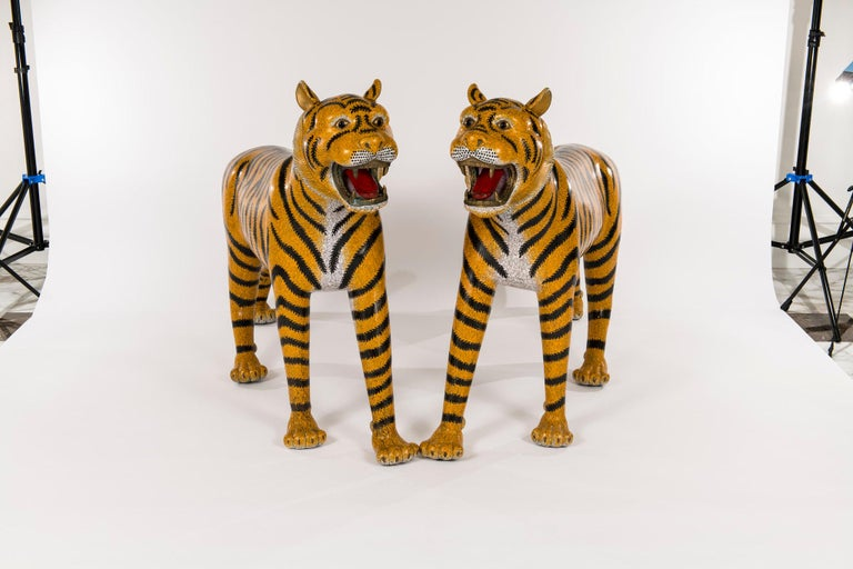 A stunning pair of late 20th century life-size Chinese cloisonné tigers from the Baron Estate.   In Chinese symbolism, these tigers represents the masculine principle in nature and is king of all the animals, as shown by the four stripes on his