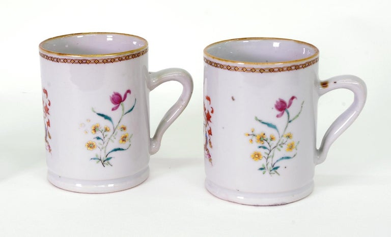 Pair of Chinese export porcelain armorial small mugs, each with the arms of Amyas and decorated with flower sprigs.  See David S. Howard Chinese, Armorial Porcelain Vol I (London: Faber and Faber Limited, 1974), 532.