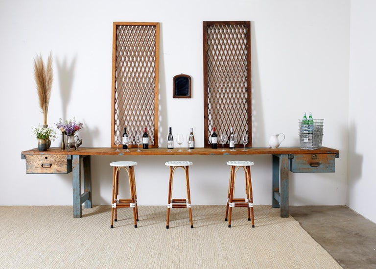 Near pair of wood Chinese window panels or grates featuring a geometric lattice design. Mortise and tenon joinery with parcel painted finish and Chinese writing on one door as seen in photos. One panel is 1/2 inch smaller than the other as seen in