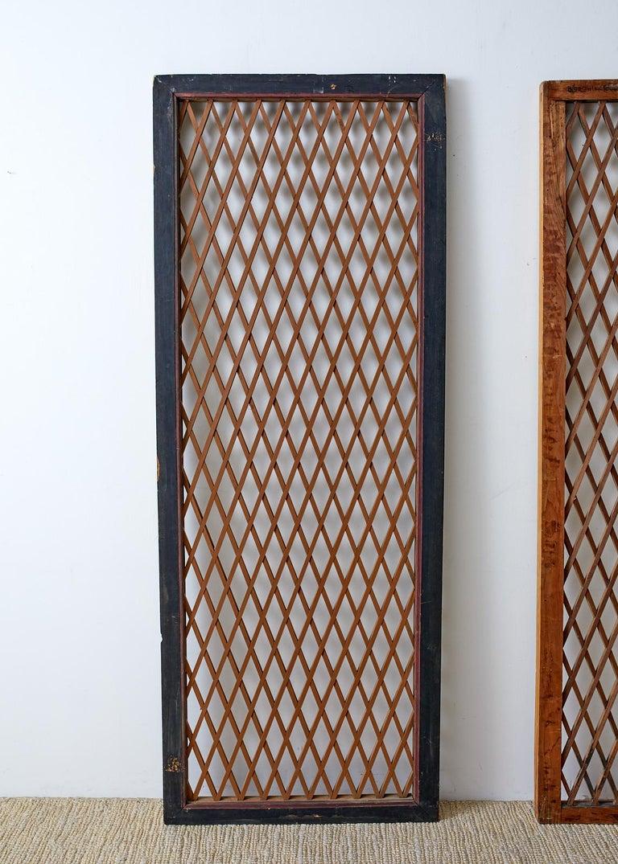 Wood Pair of Chinese Geometric Lattice Window Panels For Sale