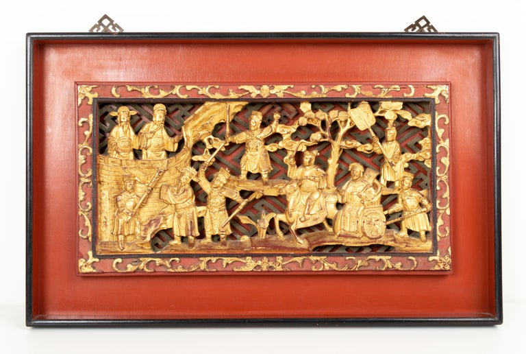 A superb pair of elaborately carved Chinese gilded panels, depicting a warrior scene. China, C.1920
