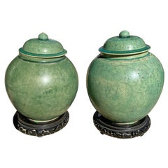 Pair of Chinese Green Glazed Vessels/Jars with Lids