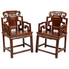 Pair of Chinese Hardwood Chairs with Fretwork Designs and High Relief Panels