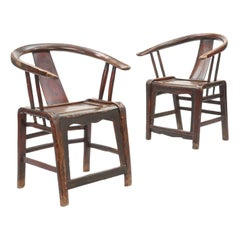 Pair of Chinese Horseshoe-Back Elmwood and Hardwood Armchairs