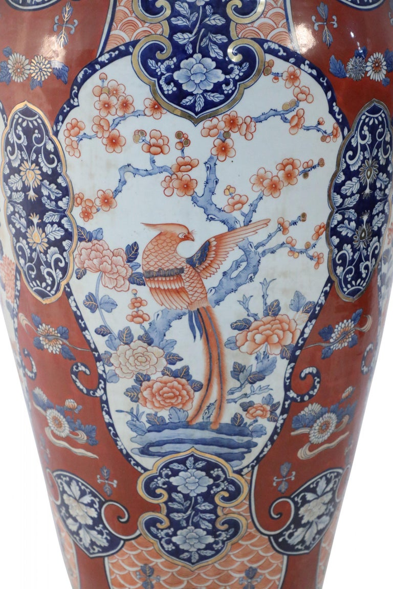 20th Century Pair of Chinese Imari-Style Monumental Lidded Porcelain Urns For Sale