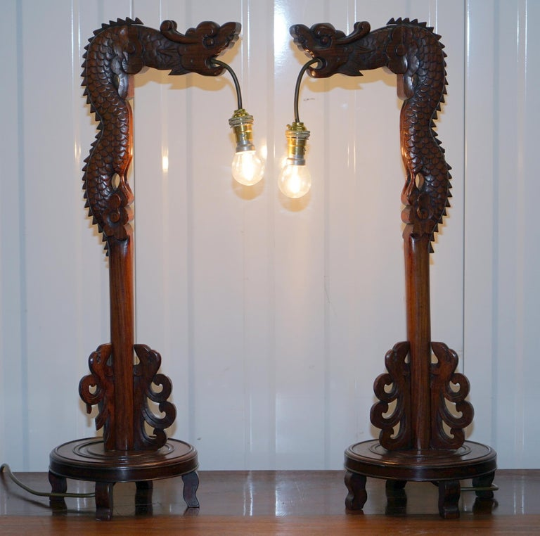 We are delighted to offer for sale this lovely pair of hand carved wood Chinese dragon table lamps