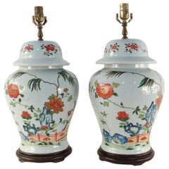 Pair of Chinese Off-White Floral Porcelain Urn Table Lamps Mounted on Wood Base