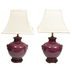 Pair of Chinese Oxblood Glazed Urn Shaped Table Lamps with Haut Relief, 20th C