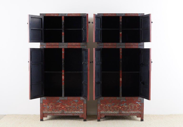 Chinese Export Pair of Chinese Polychrome Decorated Compound Dragon Cabinets For Sale