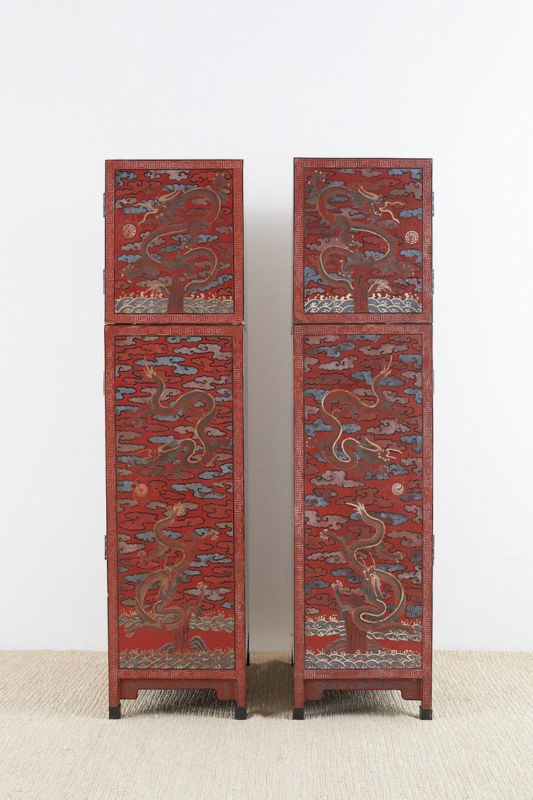 Ebonized Pair of Chinese Polychrome Decorated Compound Dragon Cabinets For Sale
