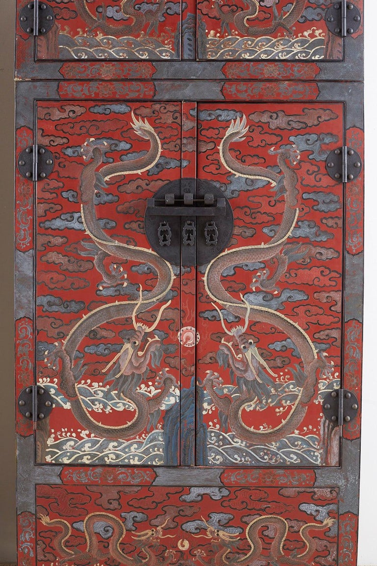 20th Century Pair of Chinese Polychrome Decorated Compound Dragon Cabinets For Sale