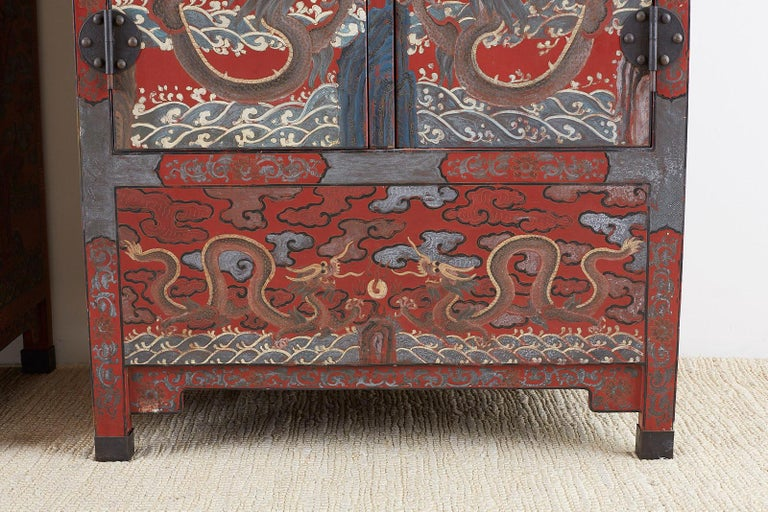 Pair of Chinese Polychrome Decorated Compound Dragon Cabinets For Sale 1