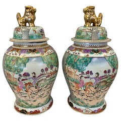 Pair of Chinese Porcelain Urns with Fox Hunt Scenes