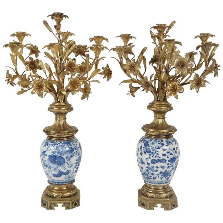 Pair of Chinese Porcelain Vases Mounted with Gilded Bronze Candelabra Tops For Sale