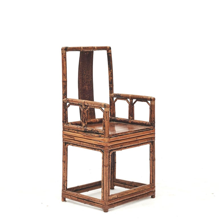 Pair of Chinese bamboo chairs each with wooden inset rectangular panel and seat. Original condition with minor losses to the burgundy lacquer. Finished with a transparent lacquer which highlights the unique and natural patina.  From Jiangsu