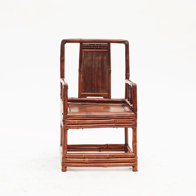 Pair of Chinese bamboo chairs each with inset rectangular panel with calligraphy lettering, China, 1860-1880. Original condition with a rich, warm patina. Sold as a pair.