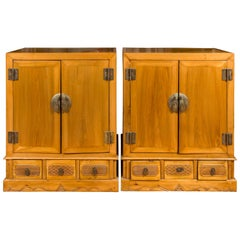 Pair of Chinese Qing Dynasty Carved Yumu Wood Cabinets with Doors and Drawers