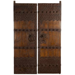 Pair of Chinese Qing Dynasty Palace Doors with Iron Hardware and Dark Patina