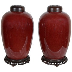 Pair of Chinese Sang Du Bouf lidded vases, circa 1890
