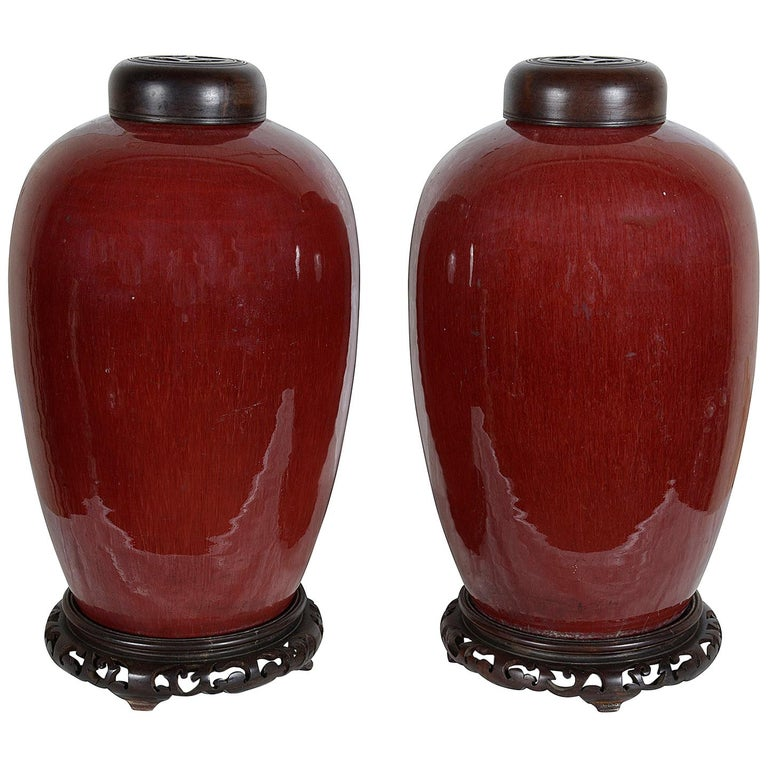Pair of Chinese Sang Du Bouf lidded vases, circa 1890 For Sale