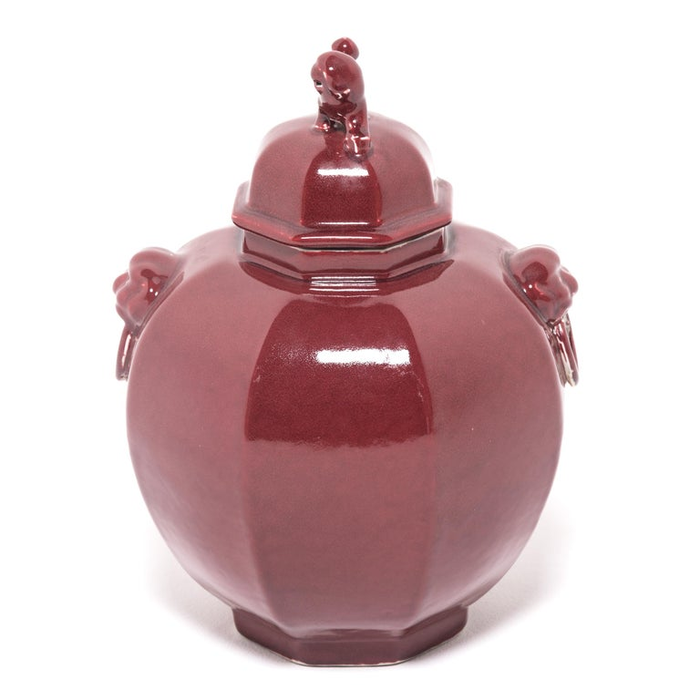 A rich, monochrome red glaze coats this ginger jar shaped contemporary vase, drawing attention to its updated profile and its sculptural Fu dog top. Referred to as shizi, these mythical, canine-like lions are natural protectors. Sculptures of these