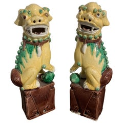 Pair of Chinese Yellow Glazed Foo Dogs, Republic Period, Early 20th Century