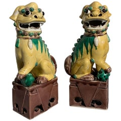 Pair of Chinese Yellow Glazed Porcelain Foo Dogs, circa 1930s