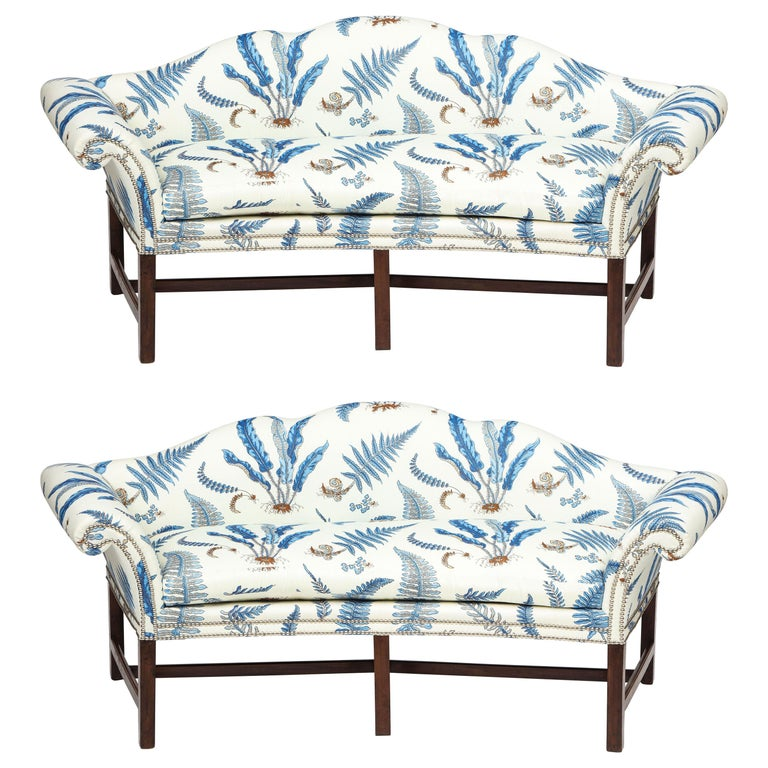 Pair of Chippendale Style Mahogany Camelback Sofas For Sale