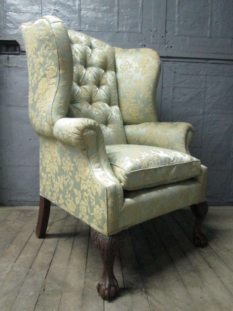 Pair of Chippendale style wingback chairs with wooden ball-n-claw feet.