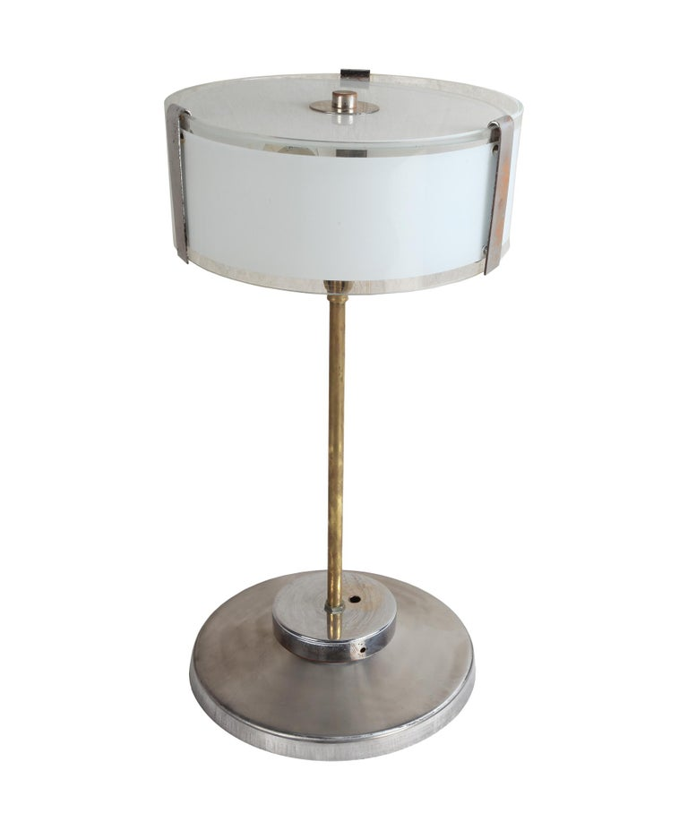 Pair of chrome Mid-Century Modern table lamps with frosted glass shade. Brass stem. Each lamp has two standard size light sockets and rewired for American use. European. These could actually look great as pendants, see the last photo. Just the shade