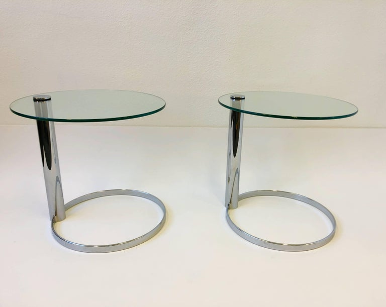 """A amazing pair of polish chrome and glass side tables by John Mascheroni for Swaim. New glass tops. Dimension: 22"""" diameter, 21"""" high."""