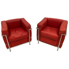 Pair of Chrome and Red Leather Club Chairs in the Style of Le Corbusier