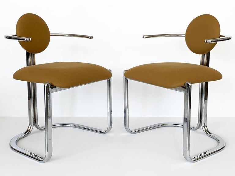 Pair of chrome modernist armchairs by Gastone Rinadli for Thema Italy, circa 1970s. Newly upholstered in a camel colored wool felt fabric. Postmodern in style with a 10