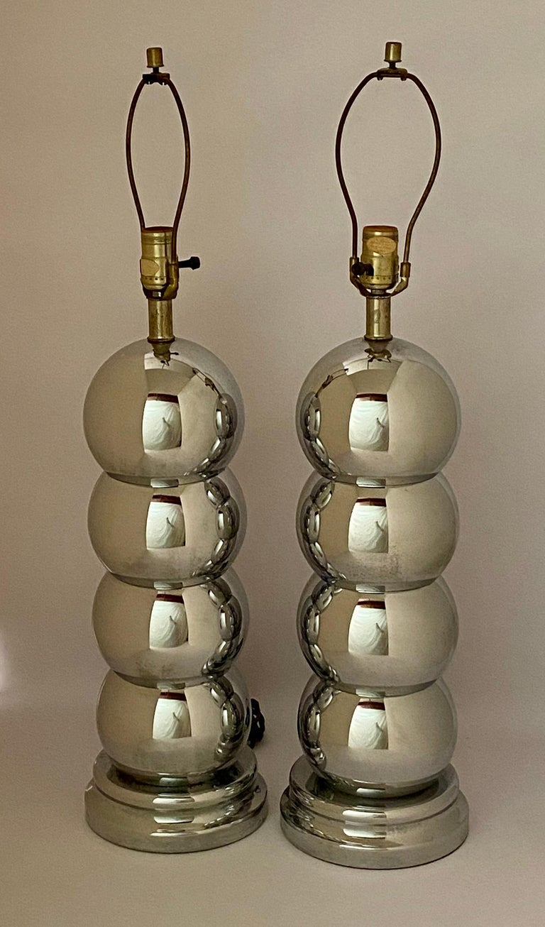Fine pair of polished chrome caterpillar table lamps. Good overall condition with working wiring. Harps included. Shades not included. Some light pitting around bases, circa 1970.  Approximately 29