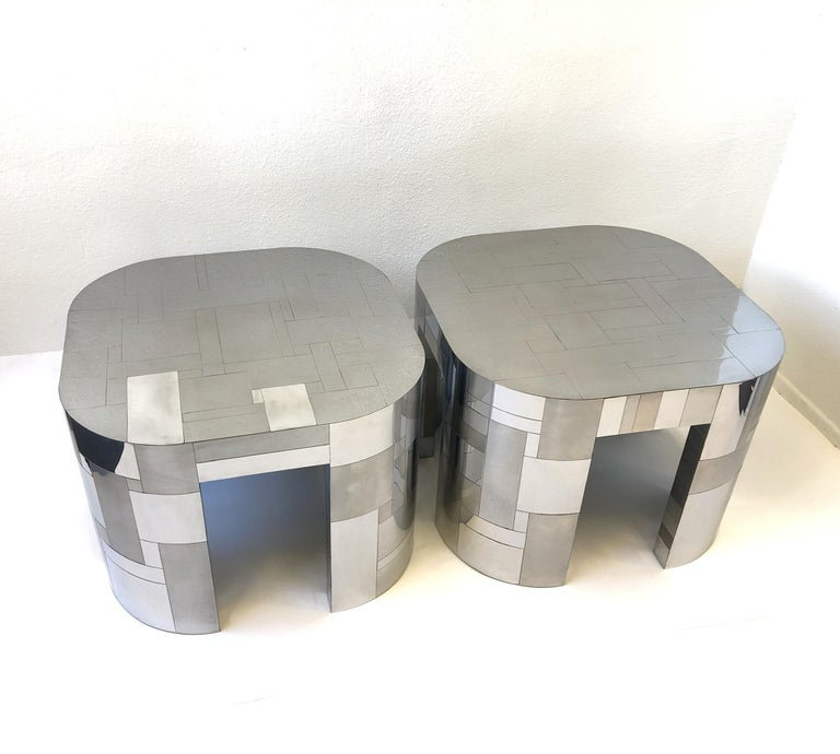 A glamorous pair of polish and satin chrome side table from the Cityscape collection design by Paul Evans in the 1970s. Both tables have the Paul Evans signature. The tables came out of British tycoon Lord James Hanson Palm Springs estate.