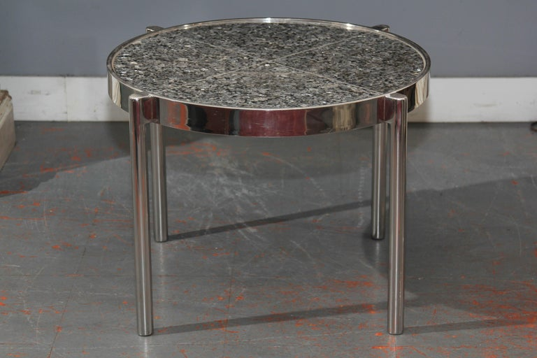 Pair of side tables with chromed frame with a quadrant granite top with chrome