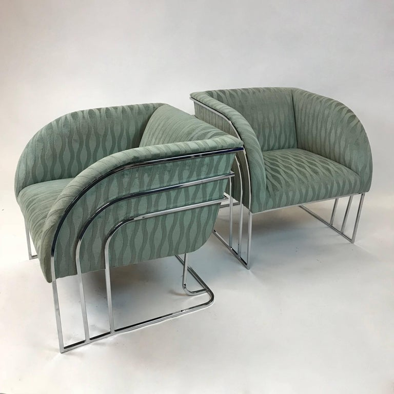 Stunning pair of club, lounge chairs by George Mergenov for Weiman/Warren Lloyd featuring rainbow, chrome frames are newly upholstered in moss green jacquard. These chairs are very much in the style of Milo Baughman and are sometimes attributed to