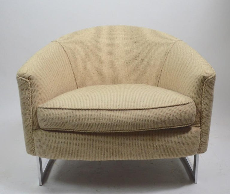 Very stylish pair of lounge chairs with exposed chrome strap frames and tweed upholstered seats and backs. Extremely well constructed, in very good original condition, upholstery shows some light wear, normal and consistent with age. Usable as is,