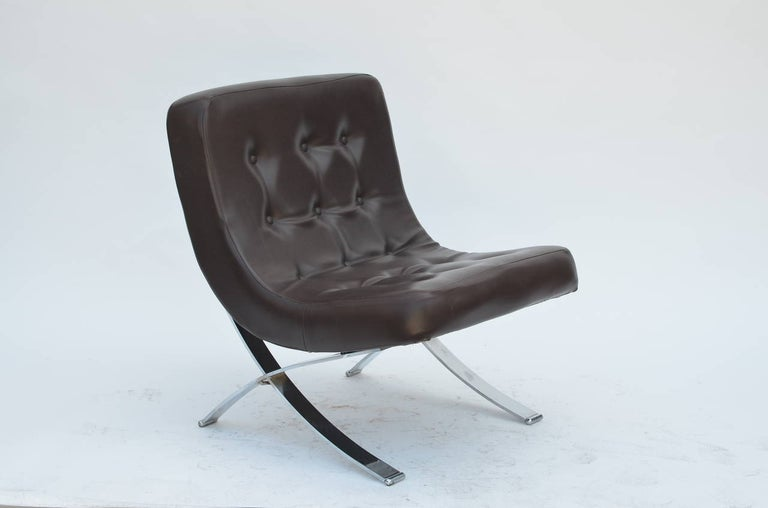 Pair of chromed Italian 1970s slipper chairs. Original dark brown vinyl seats in excellent condition. Great vintage design for a change from the Barcelona chair.