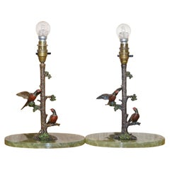 Pair of circa 1920 Cold Painted Bronze Lamps of Presents in Trees with Onyx Base